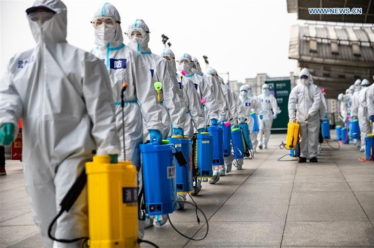 One year on, COVID-19 pandemic still disrupting lives - ảnh 1