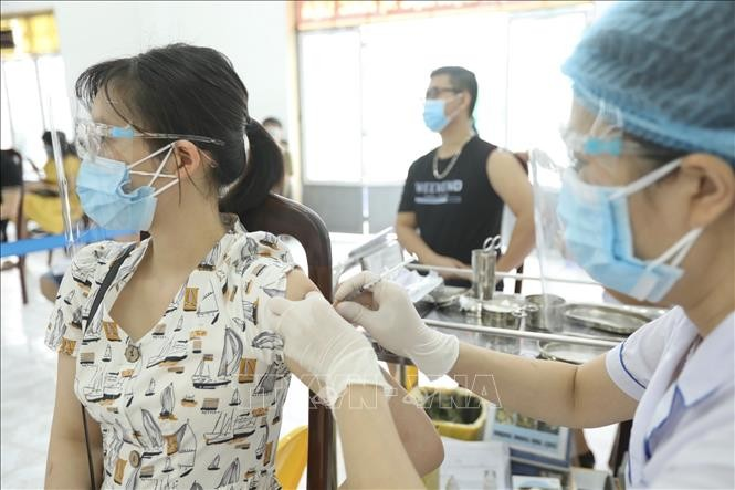 COVID-19: Vietnam reports 11,521 new cases, 9,900 recoveries on Friday  - ảnh 1