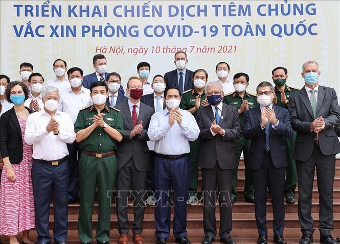 Вьетнам осуществляет всереспубликанскую кампанию вакцинации от COVID-19  - ảnh 1