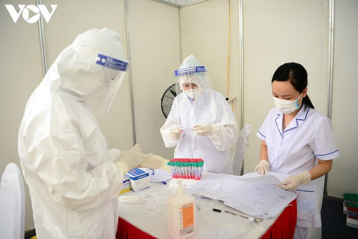 Hanoi continues to conduct RT-PCR tests for returnees from Da Nang - ảnh 13