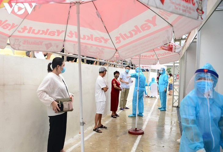 Hanoi continues to conduct RT-PCR tests for returnees from Da Nang - ảnh 7