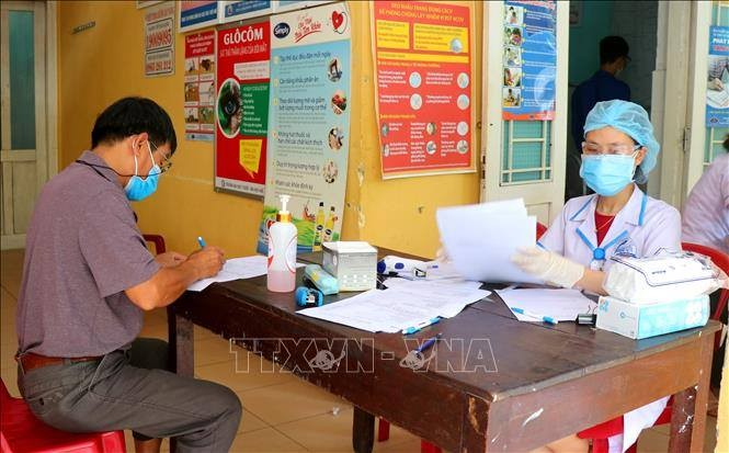 Localities strengthen measures to fight against COVID-19 - ảnh 1