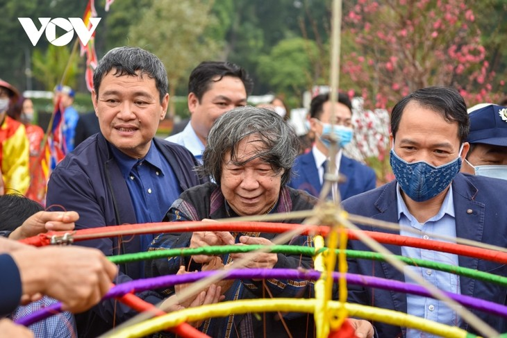 Thang Long relic site sees reenactment of traditional Tet rituals - ảnh 11