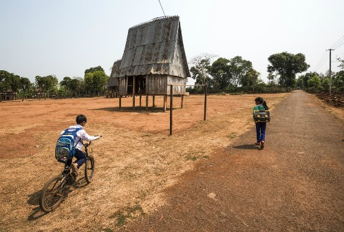 Niños de minorías étnicas a través del lente fotográfico - ảnh 9