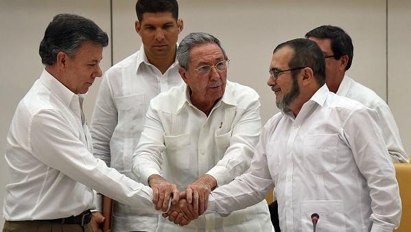 Proceso de paz en Colombia: La guerrilla y el gobierno firman acuerdo judicial  - ảnh 1