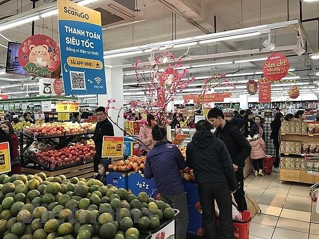 Reanudan actividades comerciales en Hanói en el segundo día feriado del Año Nuevo Lunar - ảnh 1