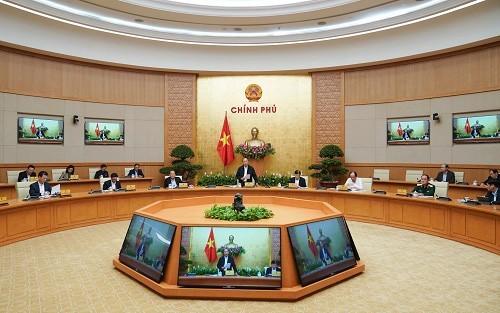 Premier vietnamita insiste en contener el Covid-19 con determinación y medidas apropiadas - ảnh 1