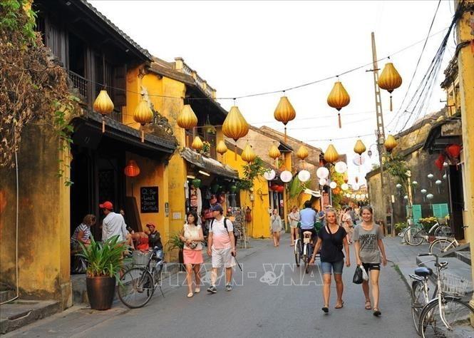 Encomian la movilización de las masas en la preservación de patrimonios en Hoi An - ảnh 1