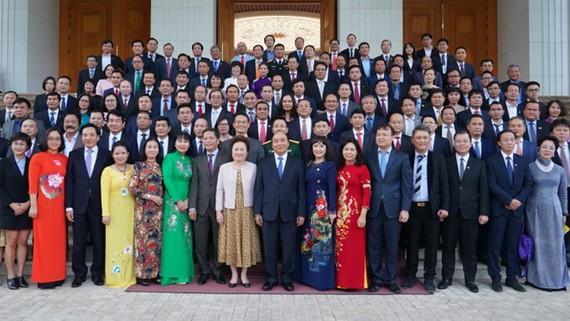 Premier vietnamita confía en un mayor desarrollo del empresariado nacional - ảnh 1