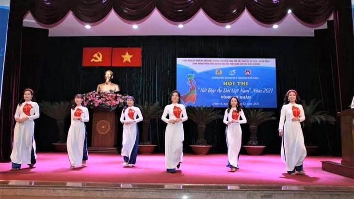 """Mujeres de Ciudad Ho Chi Minh lucen el """"Ao Dai"""" en oficinas de trabajo   - ảnh 2"""