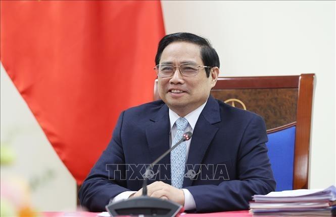Covid-19 : Entretien entre Pham Minh Chinh et la directrice générale de Covax - ảnh 1