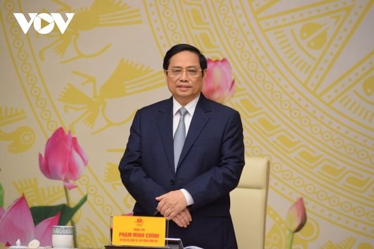 Pham Minh Chinh rencontre des hommes d'affaires à Hanoï - ảnh 1