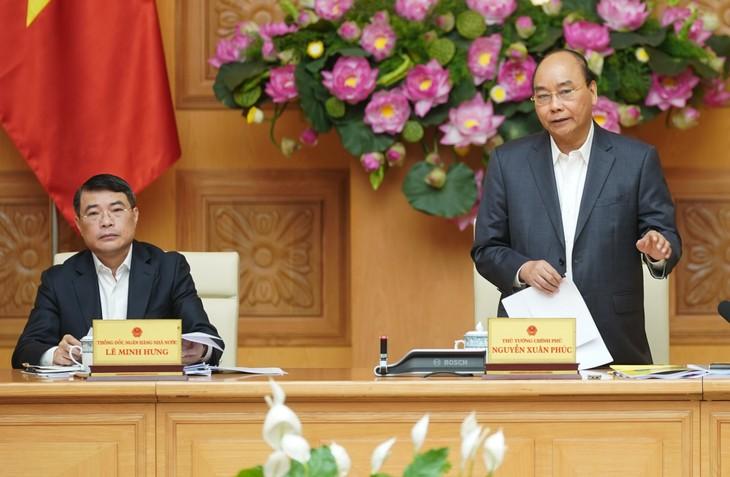 นายกรัฐมนตรีเหงียนซวนฟุ๊กเป็นประธานการประชุมสภาที่ปรึกษานโยบายการเงินแห่งชาติ - ảnh 1