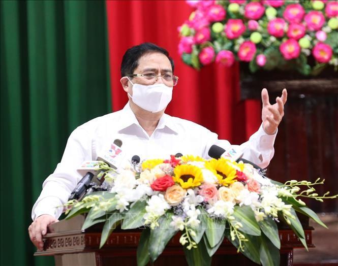 นายกรัฐมนตรี ฝ่ามมิงชิ้ง ลงพื้นที่พบปะผู้มีสิทธิ์เลือกตั้งนครเกิ่นเทอ - ảnh 1