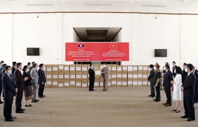 Laos values Vietnam's support in fighting Covid-19 - ảnh 1