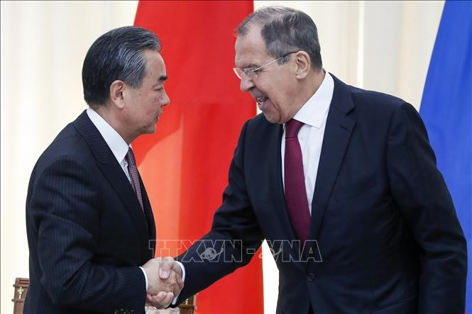 China, Russia oppose unilateralism, protectionism - ảnh 1