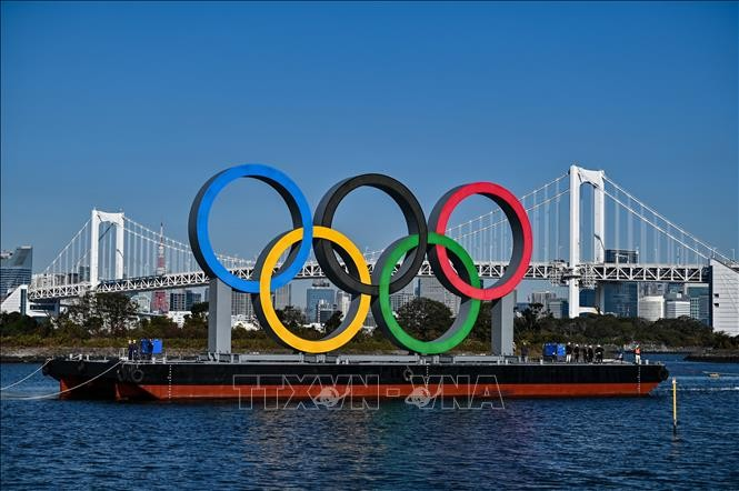 Japan considers limiting Olympics venues to 50% of capacity  - ảnh 1