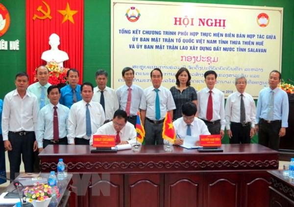 Thúc đẩy hợp tác trong công tác mặt trận giữa các địa phương Việt - Lào  - ảnh 1