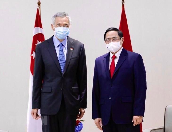 Thủ tướng Phạm Minh Chính tiếp xúc song phương với Thủ tướng Singapore - ảnh 2
