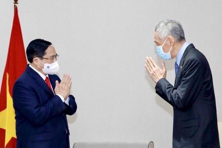 Thủ tướng Phạm Minh Chính tiếp xúc song phương với Thủ tướng Singapore - ảnh 1