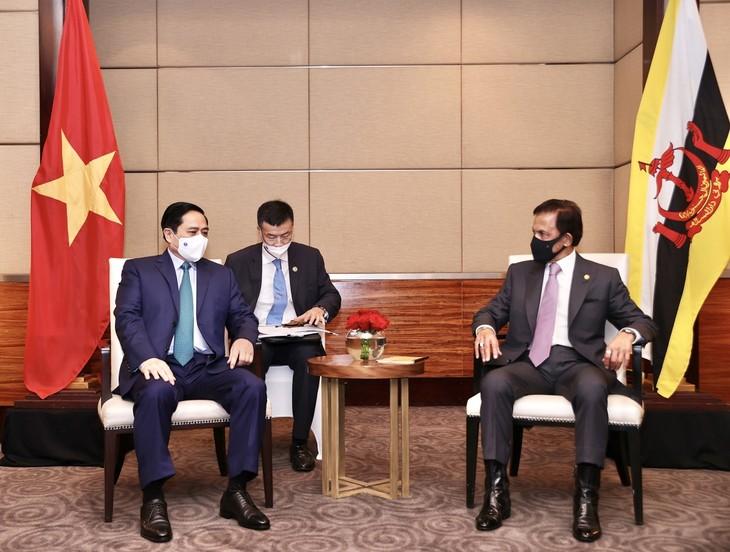 Nhìn lại chuyến công du nước ngoài đầu tiên của Thủ tướng Phạm Minh Chính - ảnh 12