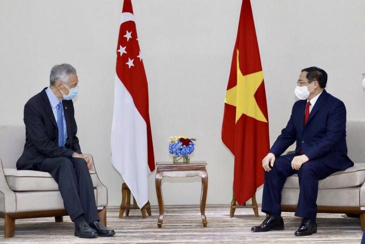 Nhìn lại chuyến công du nước ngoài đầu tiên của Thủ tướng Phạm Minh Chính - ảnh 15