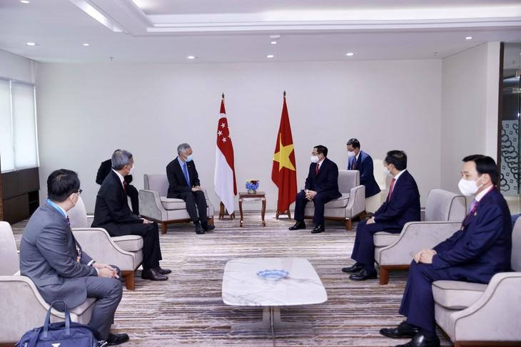 Nhìn lại chuyến công du nước ngoài đầu tiên của Thủ tướng Phạm Minh Chính - ảnh 16