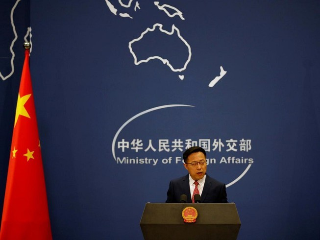 China condemns US's COVID-19 accusation  - ảnh 1