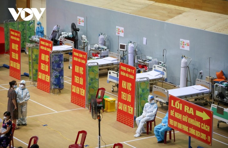 Initial COVID-19 vaccination drive begins in Da Nang - ảnh 17