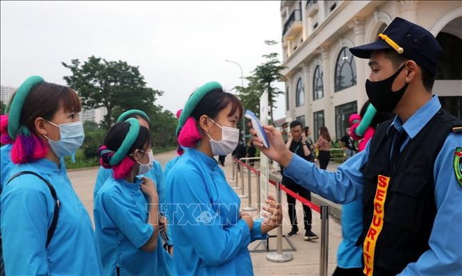 Во Вьетнаме было зарегистрировано 14 новых ввозных случаев  COVID-19 - ảnh 1