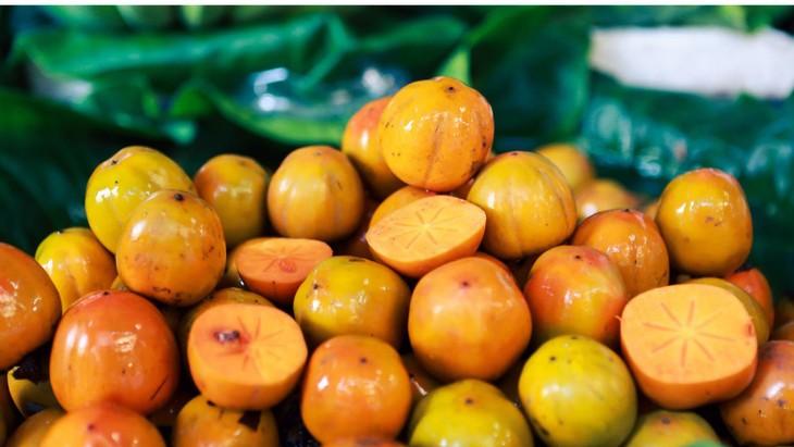 Маринованная хурма – простой осенний фрукт Ханоя - ảnh 2