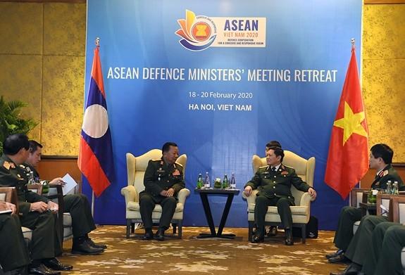 Đại tướng Ngô Xuân Lịch gặp song phương Bộ trưởng Quốc phòng Lào, Australia - ảnh 1