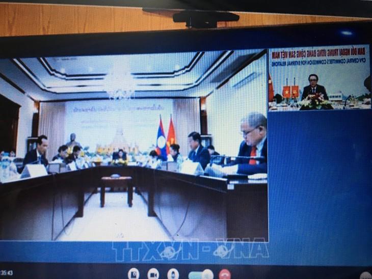 Hội đàm trực tuyến hai Ban đối ngoại Đảng CSVN với Ban đối ngoại TƯ Đảng NDCM Lào - ảnh 1