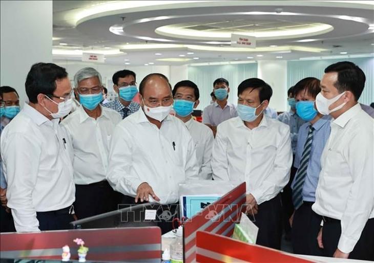 Chủ tịch nước Nguyễn Xuân Phúc thăm một số cơ quan báo chí lớn của Thành phố Hồ Chí Minh - ảnh 1