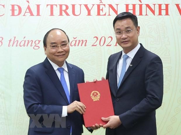 Премьер-министр Нгуен Суан Фук вручил решение о назначении генерального директора Национального телевидения Вьетнама  - ảnh 1