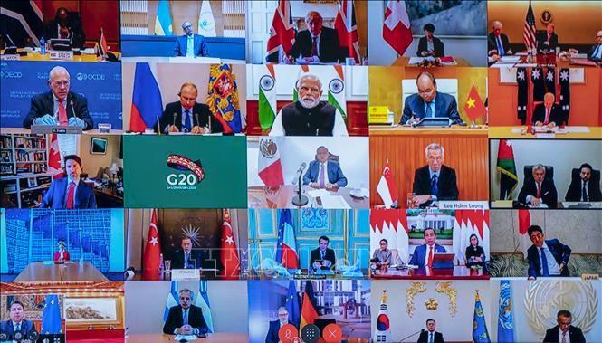 """ក្រុម G-20 សន្យាថានឹងធ្វើអ្វីគ្រប់បែបយ៉ាងដើម្បីកាត់បន្ថយហានិភ័យសេដ្ឋកិច្ចពិភពលោក""""ធ្លាក់ចុះ"""" - ảnh 1"""