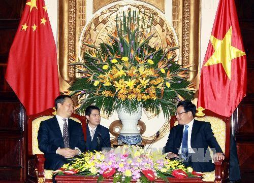 Bộ trưởng Ngoại giao Phạm Bình Minh tiếp Bí thư Khu ủy Khu tự trị dân tộc Choang - ảnh 1