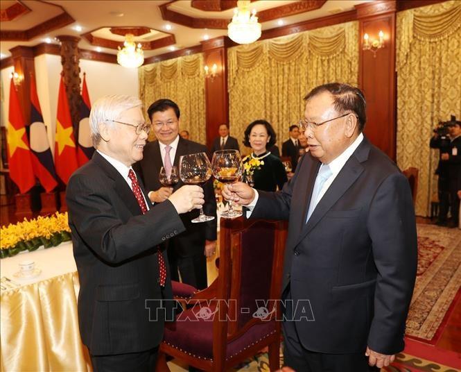 Mãi mãi giữ gìn, vun đắp phát triển mối quan hệ đặc biệt Việt Nam – Lào - ảnh 1