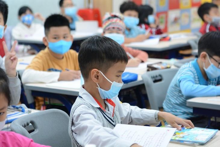 Bộ Giáo dục và Đào tạo hướng dẫn khi học sinh trở lại trường sau thời gian tạm nghỉ học vì dịch cúm - ảnh 1