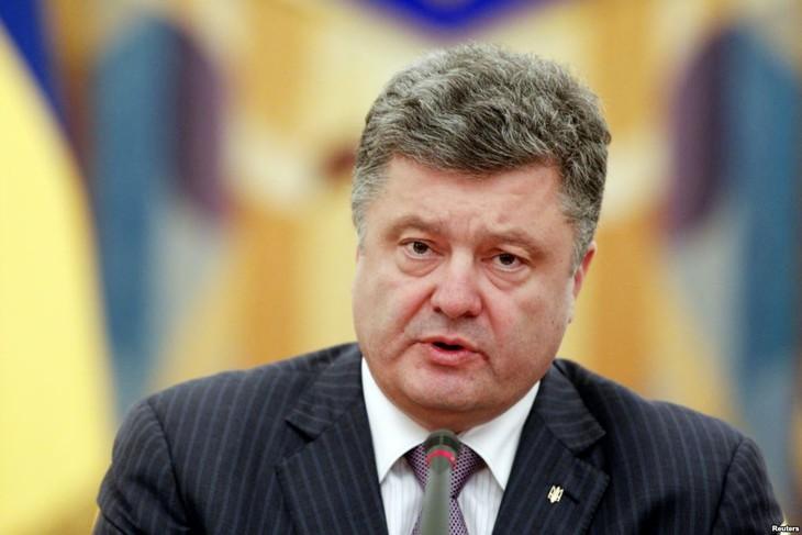 กลุ่มโปโรเชนโกมีความได้รับเสียงสนับสนุนข้างมากก่อนการประชุมรัฐสภายูเครน - ảnh 1
