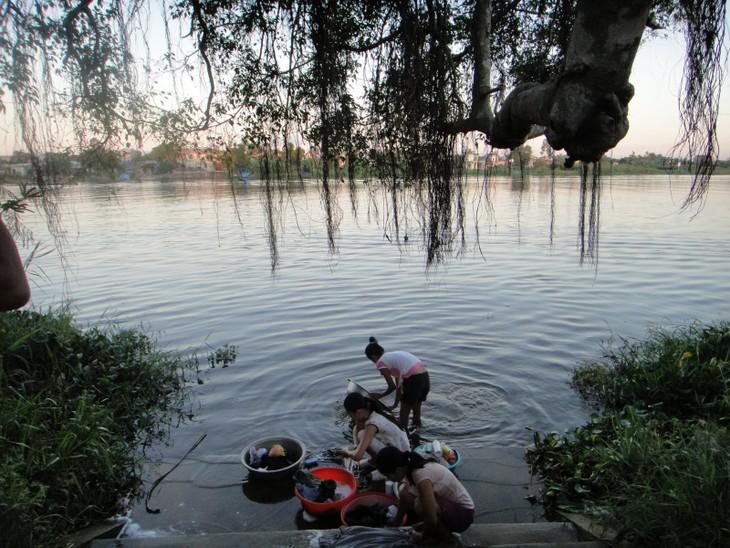 บรรยากาศการดำเนินชีวิตของหมู่บ้านเวียดนาม - ảnh 2