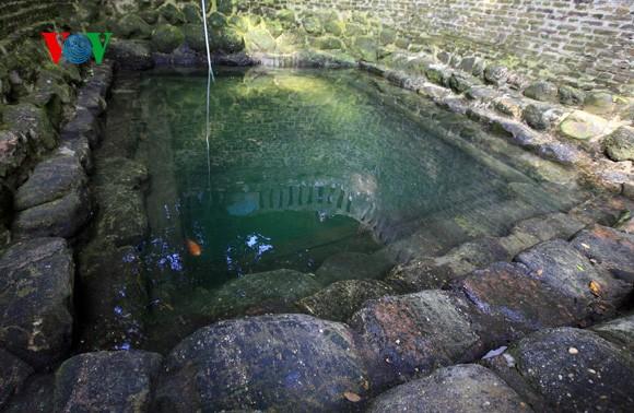 บ่อน้ำสะท้อนชีวิตทางจิตวิญญาณของชาวบ้าน - ảnh 2