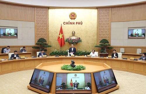 นายกรัฐมนตรีเวียดนามเสนอให้สถานประกอบการร่วมกันปฏิบัติ 2 มาตรการ - ảnh 1