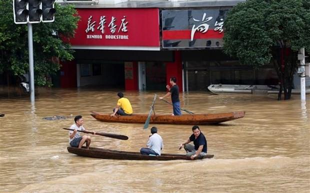 จีนออกคำเตือนระดับน้ำของแม่น้ำต่างๆขึ้นสูงเป็นประวัติกาล  - ảnh 1