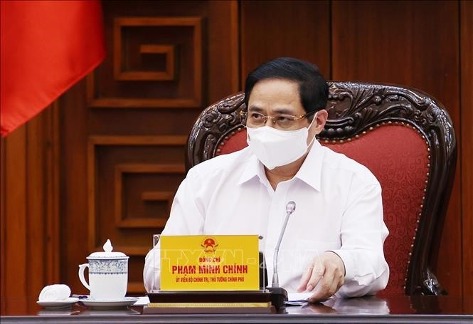การประชุมประจำของรัฐบาลเกี่ยวกับการป้องกันและรับมือการแพร่ระบาดของโรคโควิด -19 - ảnh 1