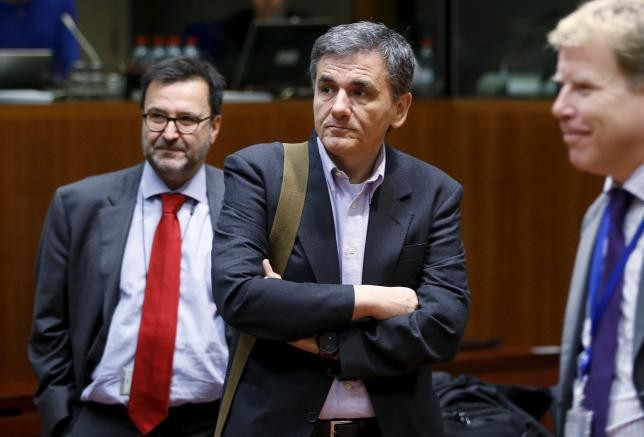 Greece, lenders reach deal to unlock further bailout funds - ảnh 1