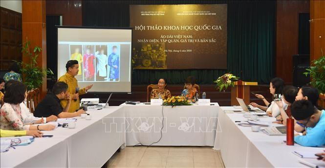 National symposim on Vietnam's traditional long dress  - ảnh 1