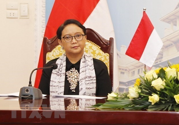 Indonesia's top diplomat urges for Beijing cooperation in regional security   - ảnh 1