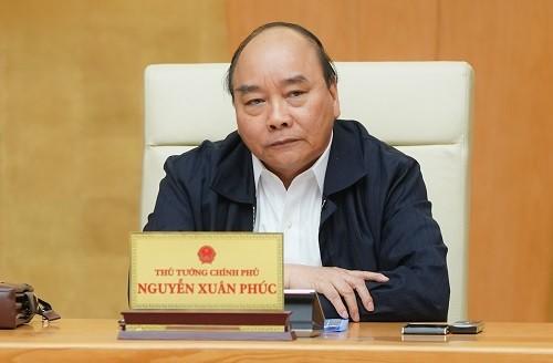 Premier vietnamita pide implementar estrictas medidas anticovid-19 - ảnh 1