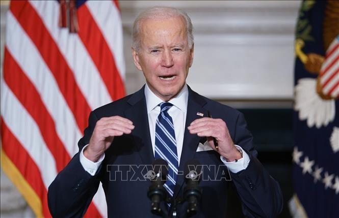Biden promete impulsar el rescate económico y los planes de vacunación contra el covid-19 - ảnh 1